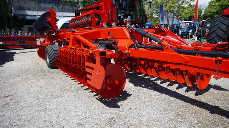 Photo pour The disk harrow. Agricultural machinery for processing of the soil in the field. - image libre de droit