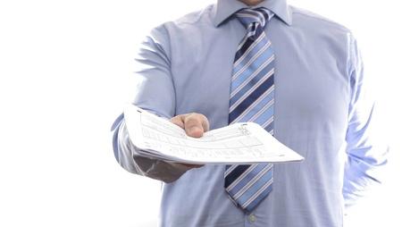 Photo pour Businessman showing document - image libre de droit
